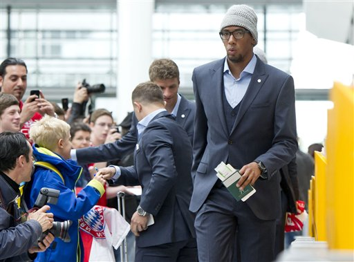 Munichs  soccer player Jerome Boateng  on his way to board a plane to London at the  airport  in Munich, Germany Friday May 24, 2013. Bayern  Munich will play against  German rival Borussia Dortmund in a UEFA Champions League final on Saturday in London
