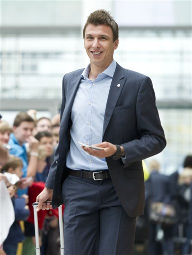 Munichs  soccer player  Mario Mandzukic  on his way to board a plane to London at the  airport  in Munich, Germany Friday May 24, 2013. Bayern  Munich will play against  German rival Borussia Dortmund in a UEFA Champions League final on Saturday in London