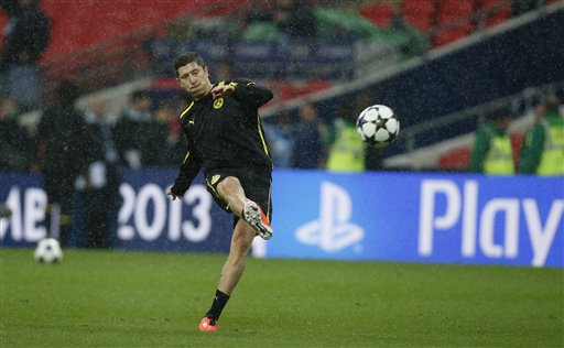 Dortmund's Robert Lewandowski of Poland kicks a ball in the rain during a training session at Wembley Stadium in London, Friday May 24, 2013. Dortmund will face fellow German soccer team Bayern Munich in the final of the Champions League at Wembley Stadium on Saturday