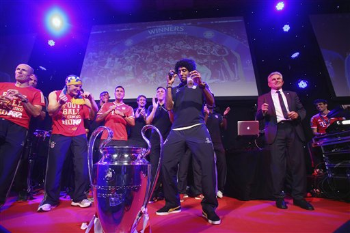Bayern's Dante of Brazil dances during the Bayern Munich Champions League Finale banquet at Grosvenor House on Saturday, May 25, 2013 after winning the soccer Champions League Final against Borussia Dortmund in London
