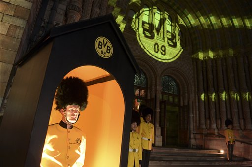 Actors in mock uniforms guard Borussia Dortmund's party at the Natural History Museum in London, England, Sunday morning May 26,  2013. Borussia Dortmund lost the Champions League final soccer match against FC Bayern Munich at Wembley stadium in London on May 25