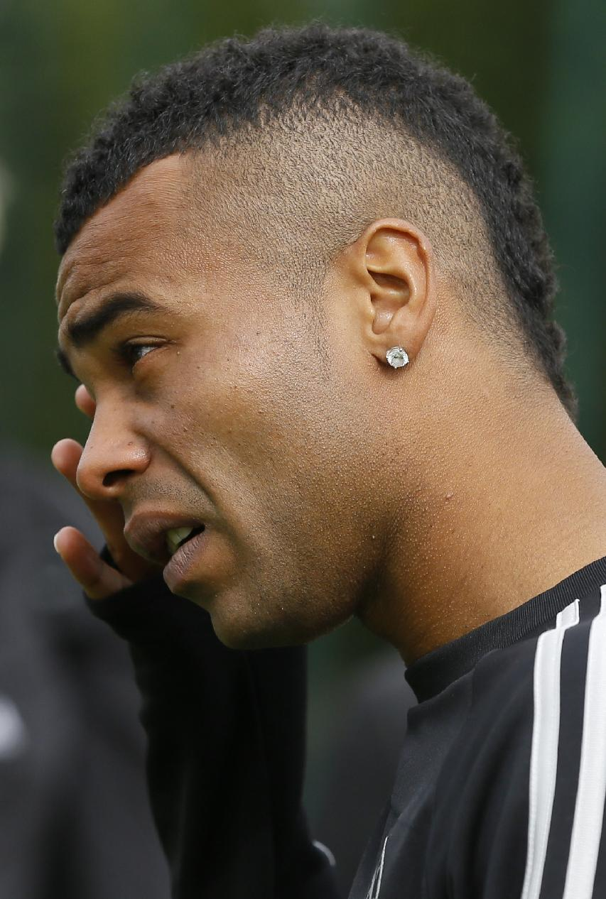 Chelsea's Ashley Cole arrives for a training session at their training ground in Cobham, Surrey, England, Tuesday, Sept. 17, 2013. Chelsea will play FC Basel in a Champions League match at Stamford Bridge on Wednesday