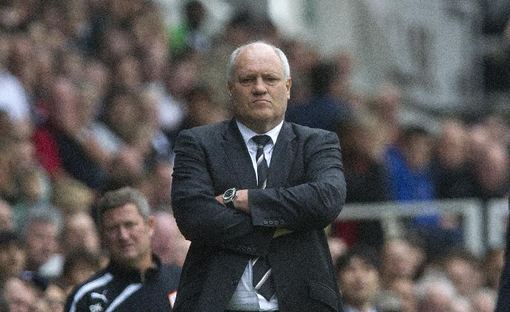 Fulham's manager Martin Jol watches their English Premier League soccer match against Cardiff City at the Craven Cottage stadium, in London, Saturday, Sept. 28, 2013