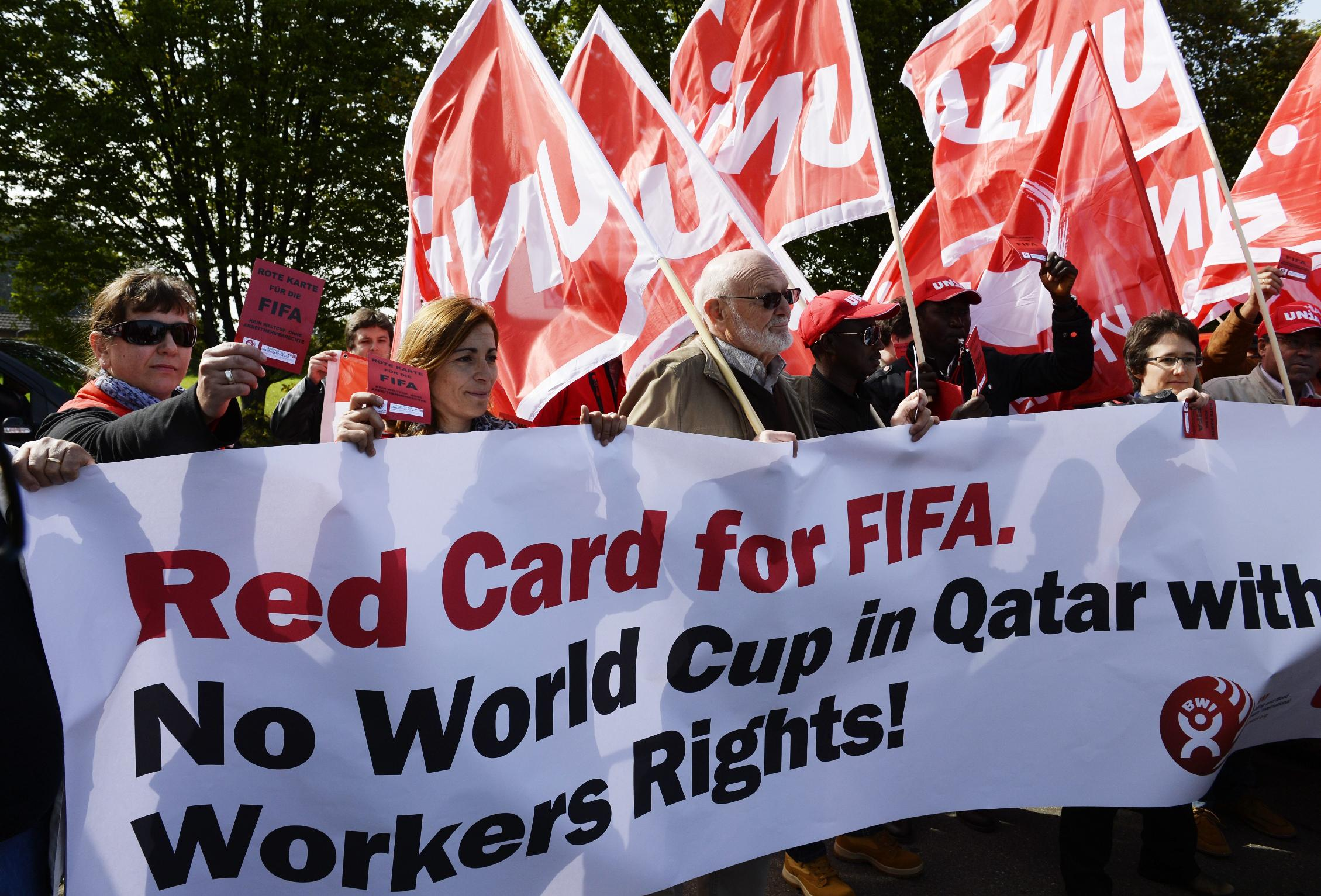 Protestors demonstrate in front of the FIFA headquarters against the working conditions in Qatar. (AP)