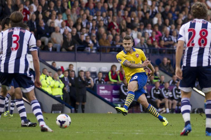 Arsenal's Jack Wilshere, centre, scores against West Bromwich Albion during their English Premier League soccer match at The Hawthorns Stadium, West Bromwich, England, Sunday, Oct. 6, 2013