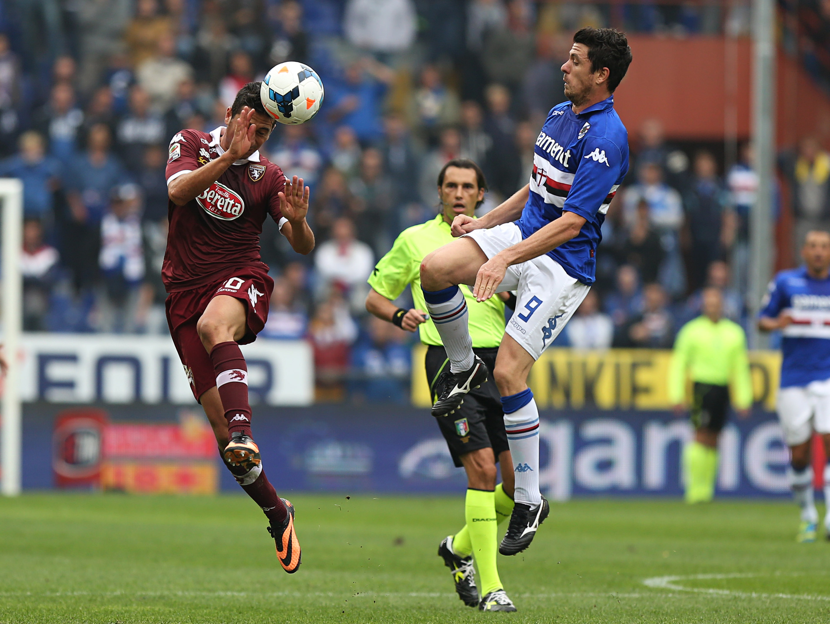 Torino midfielder Giuseppe Vives, left, and Sampdoria forward Nicola Pozzi battle for the ball during a Serie A soccer match between Sampdoria and Torino, in Genoa, Italy, Sunday, Oct. 6, 2013