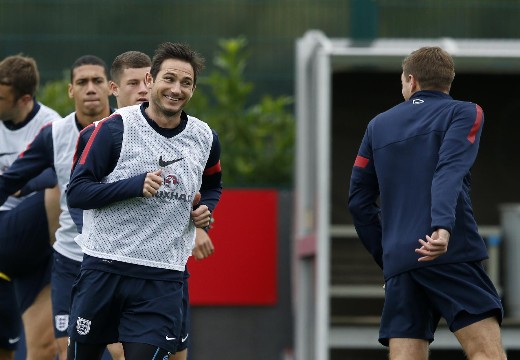 England's Frank Lampard, second right, laughs with captain Steven Gerrard, right, during a training session at facilities in London Colney, England, Monday, Oct. 14, 2013. England will play Poland in a World Cup Group H qualification soccer match at Wembley stadium in London on Tuesday