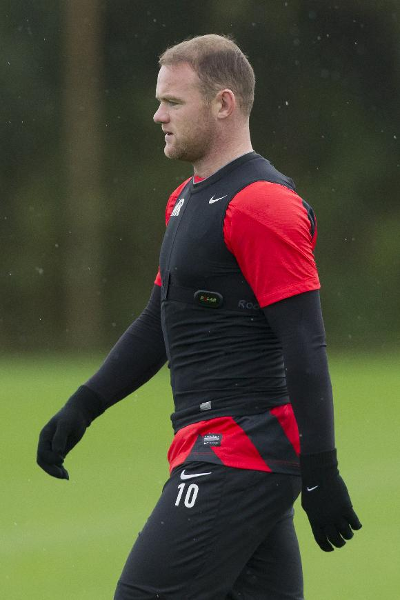 Manchester United's Wayne Rooney trains with teammates at Carrington training ground in Manchester, Tuesday, Oct. 22, 2013. Manchester United will play Real Sociedad in a Champion's League Group A soccer match on Wednesday
