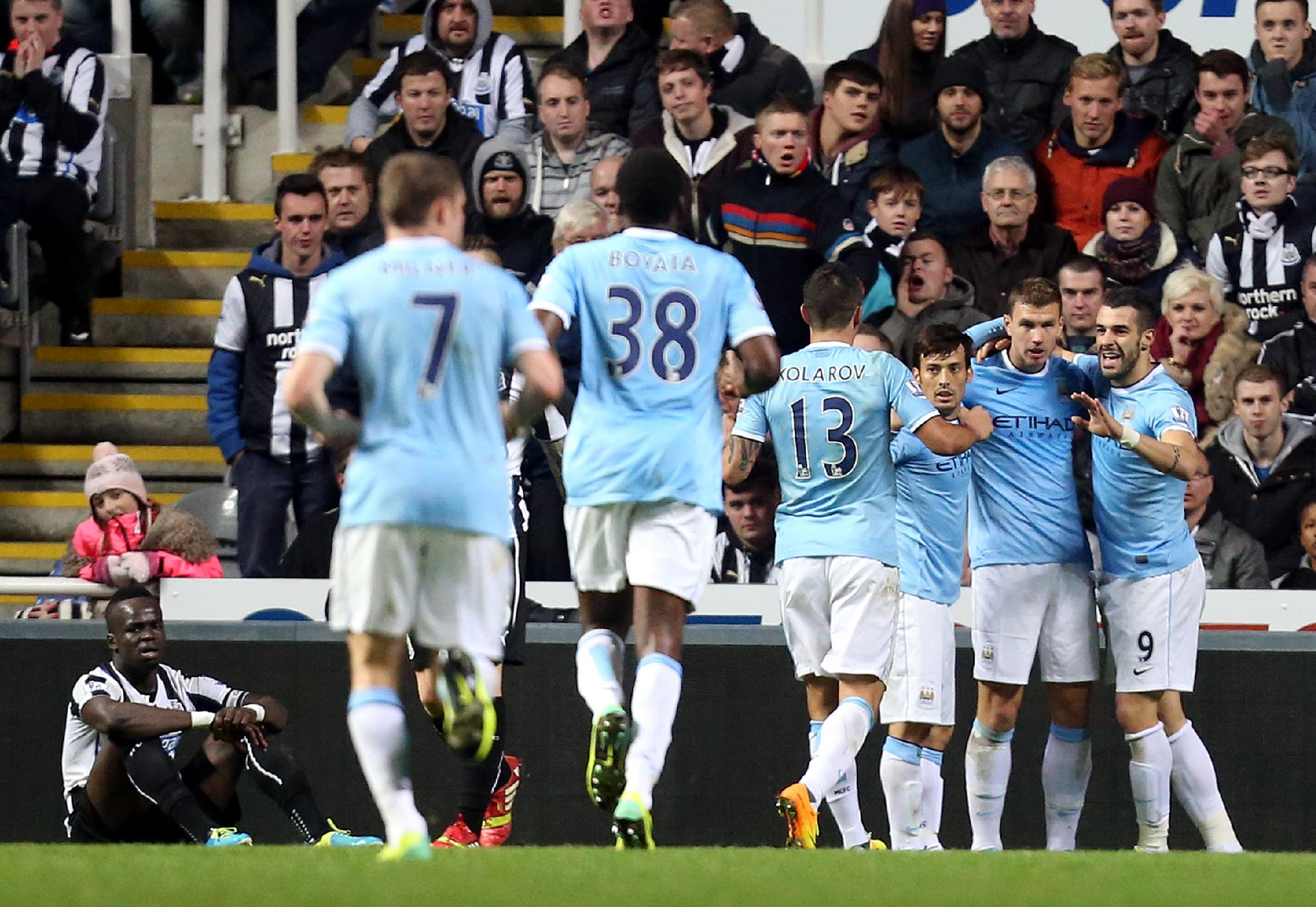 Manchester City's Alvaro Negredo, right, celebrates his goal with his teammates during their English League Cup soccer match against Newcastle United at St James' Park, Newcastle, England, Wednesday, Oct. 30, 2013