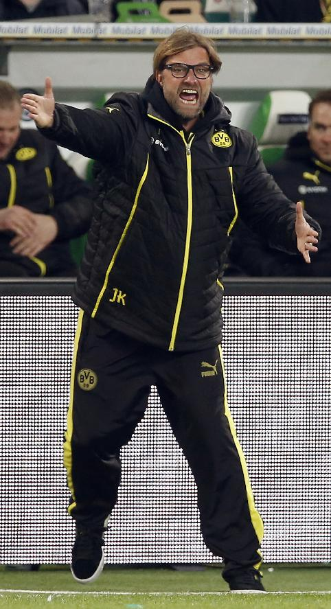 Dortmund head coach Juergen Klopp,  shouts during the German first division Bundesliga soccer match between VfL Wolfsburg and Borussia Dortmund in Wolfsburg, Germany, Saturday, Nov. 9, 2013. Wolfsburg defeated Dortmund by 2-1