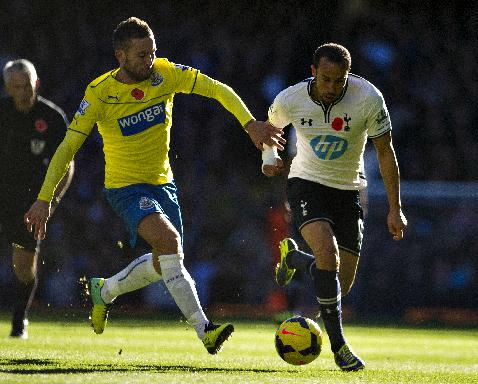 Tottenham Hotspur's Andros Townsend, right, fights for the ball with Newcastle United's Yohan Cabaye during their English Premier League soccer match, at the White Hart Lane stadium in London, Sunday Nov. 10, 2013