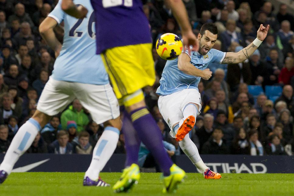 Manchester City's Alvaro Negredo, right, scores his team's first goal of the game against Swansea City during their English Premier League soccer match at the Etihad Stadium, Manchester, England, Sunday, Dec. 1, 2013
