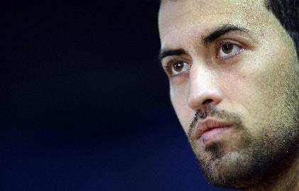 FC Barcelona's Sergio Busquets attends a press conference at the Sports Center FC Barcelona Joan Gamper in San Joan Despi, Spain, Tuesday, Dec. 10, 2013. FC Barcelona will play against Celtic in a group H Champions League next Wednesday 11 Dec