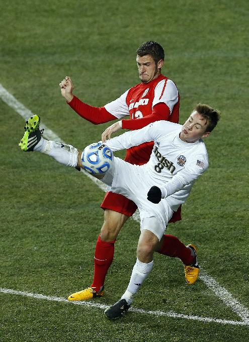 Notre Dame's Nick Besler (8) keeps the ball from New Mexico's Kyle Venter (12) in the second half during a semifinal match in the NCAA Division 1 men's soccer championships in Chester, Pa., Friday, Dec. 13, 2013. Notre Dame defeated New Mexico 2-0 to advance to Sunday's championship game