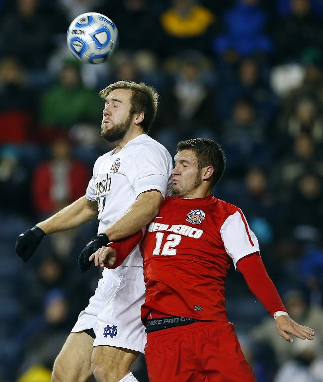 Notre Dame's Vince Cicciarelli (21) heads the ball away from New Mexico's Kyle Venter (12) in the second half during a semifinal match in the NCAA Division 1 Men's Soccer Championships at PPL Park in Chester, Pa., Friday, Dec. 13, 2013. Notre Dame defeated New Mexico 2-0 to advance to Sundays championship game