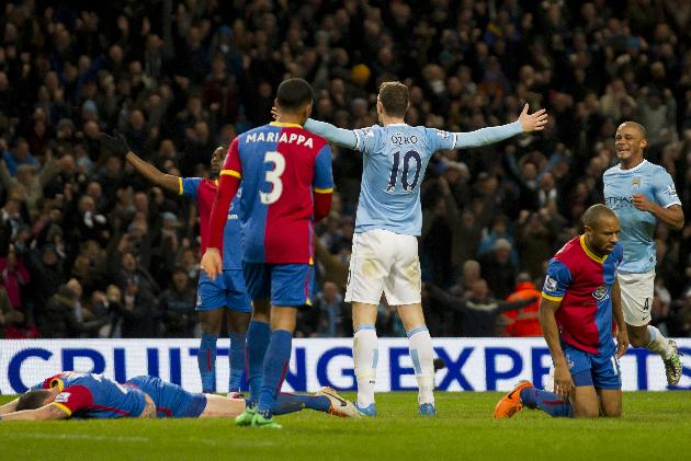 Manchester City's Edin Dzeko, centre right, celebrates after scoring against Crystal Palace during their English Premier League soccer match at the Etihad Stadium, Manchester, England, Saturday Dec. 28, 2013