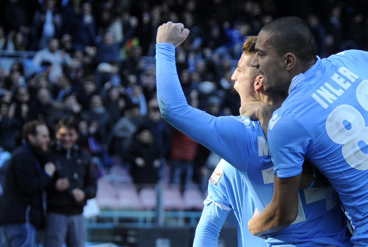Napoli's Dries Mertens, left,  celebrates after scoring with his teammates Gokhan Inler,  during a Serie A soccer match between Napoli and Sampdoria, at the San Paolo stadium in Naples, Italy, Monday, Jan. 6, 2014