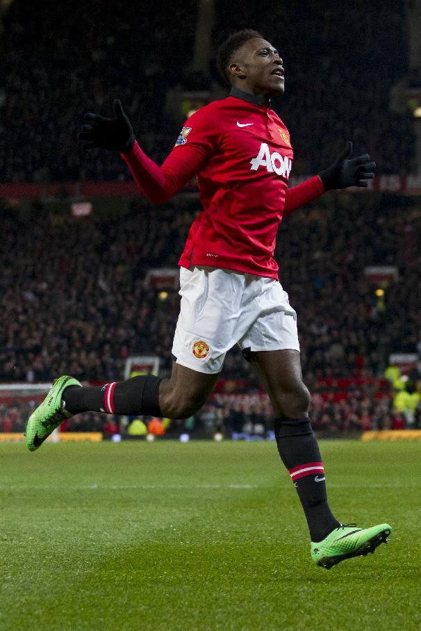 Manchester United's Danny Welbeck celebrates after scoring against Swansea City during their English Premier League soccer match at Old Trafford Stadium, Manchester, England, Saturday Jan. 11, 2014