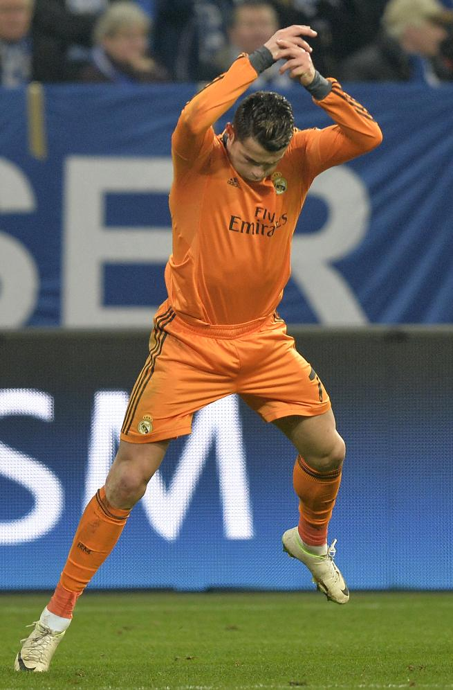Real's Cristiano Ronaldo celebrates after he scored during a Champions League round of sixteen, first leg soccer match between Schalke 04 and Real Madrid at the Veltins Arena in Gelsenkirchen, Germany, Wednesday Feb. 26, 2014