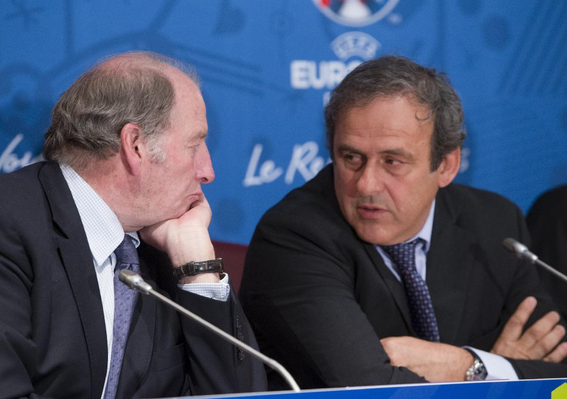 French President of the Euro 2016 organizing committee Jacques Lambert, left, speaks with UEFA president Michel Platini during a press conference for the presentation of the 2016 European Football Championship in Paris, Friday April 25, 2014. The Euro 2016 championship will run from June 10 to July 10, 2016