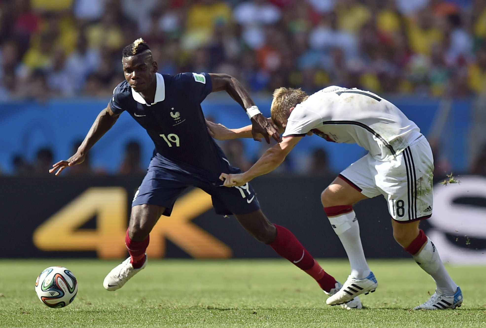 France's Paul Pogba, left, is challenged by Germany's Toni Kroos during the World Cup quarterfinal soccer match between Germany and France at the Maracana Stadium in Rio de Janeiro, Brazil, Friday, July 4, 2014
