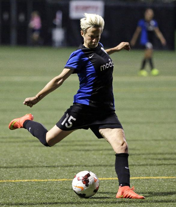 Seattle Reign FC's Megan Rapinoe shoots and scores against the Washington Spirit in the second half of an NWSL semifinal soccer match Sunday, Aug. 24, 2014, in Seattle. The Reign won 2-1