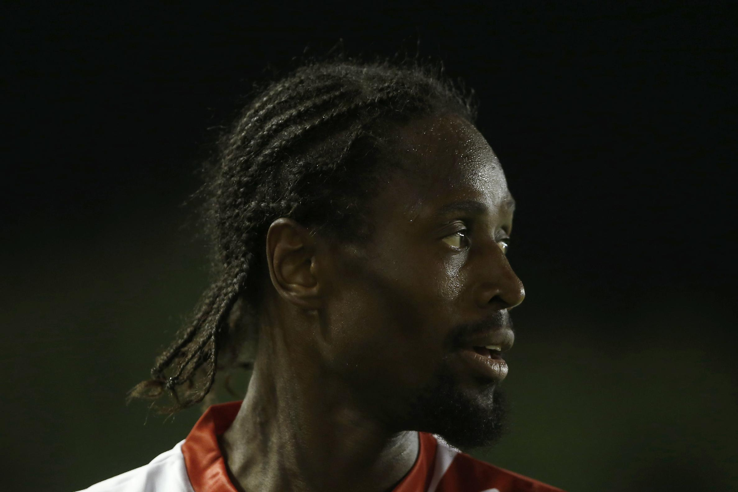 Rayo's Abdoulaye Ba, looks at the keeper during a Spanish La Liga soccer match between Rayo Vallecano and Atletico Madrid at the Vallecas stadium in Madrid, Spain, Monday, Aug. 25, 2014