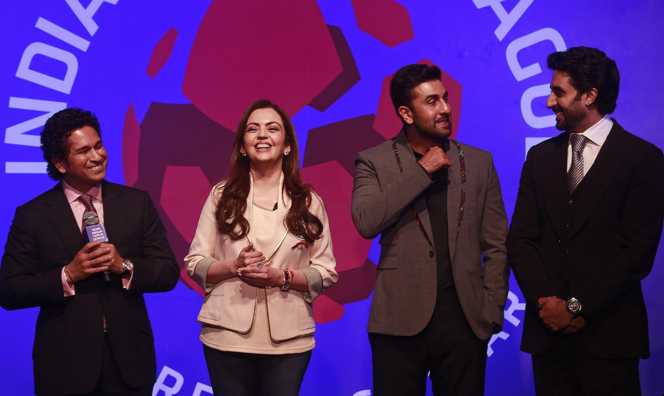 Reliance Foundation Chairman Nita Ambani, second left, stands with former Indian cricketer and co-owner of Kerala Blasters Football Club Sachin Tendulkar, left, Bollywood actor and co-owner of Mumbai City FC Ranbir Kapoor, second right, and Bollywood actor and co-owner of Team Chennai Abhishek Bachchan during the official launch of the Indian Super League (ISL) in Mumbai, India, Thursday, Aug. 28, 2014. The ISL, an initiative to popularize soccer in the country, is scheduled to begin Oct. 12