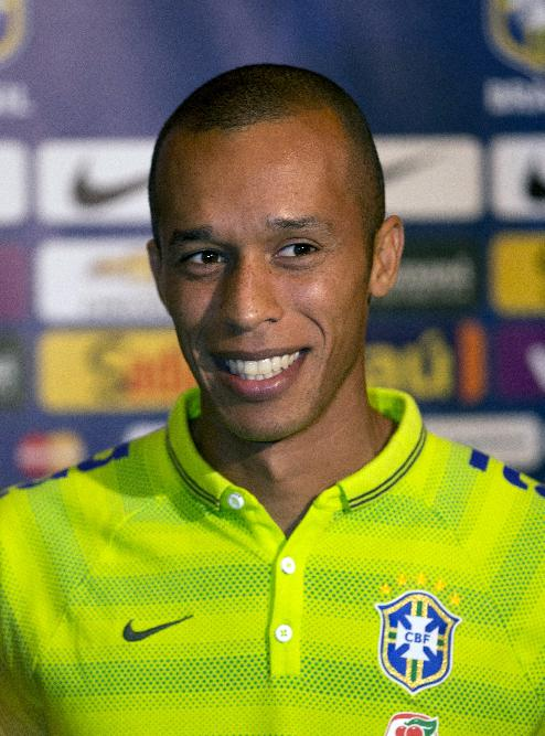 Brazil's Miranda speaks with the media during an interview Tuesday, Sept. 2, 2014, in Miami. Brazil will play Colombia in a soccer match, Friday, Sept. 5, at Sun Life Stadium in Miami