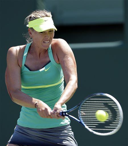 Maria Sharapova, of Russia, returns to Jelena Jankovic, of Serbia, during the semifinals of the Sony Open tennis to