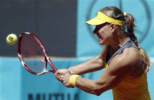 Angelique Kerber from Germany returns the ball to Alize Cornet from France during the Madrid Open tennis tournament, in Madrid, Monday, May 6, 2013