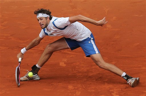 Robin Haase from The Netherlands returns the ball during the match against Jo-Wilfried Tsonga from France at the Madrid Open tennis tournament, in Madrid, Wednesday, May 8, 2013