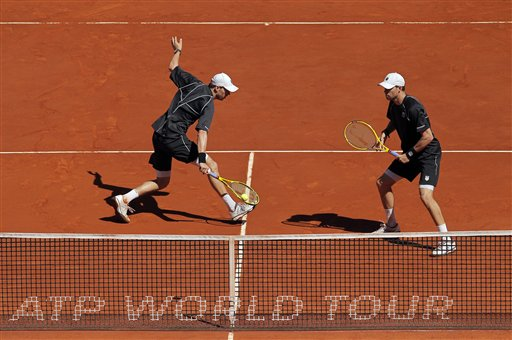 Bob Bryan and Mike Bryan from the U.S. return the ball during the doubles final match against Alexander Peya from Austria and Bruno Soares from Brazil at the Madrid Open tennis tournament, in Madrid, Sunday, May 12, 2013