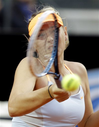 Russia's Maria Sharapova returns the ball to Spain's Garbine Muguruza during their match at the Italian Open tennis tournament in Rome, Wednesday, May 15, 2013