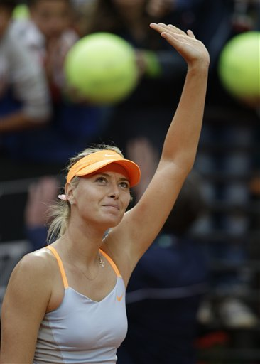 Russia's Maria Sharapova celebrates after defeating Spain's Garbine Muguruza during their match at the Italian Open tennis tournament in Rome, Wednesday, May 15, 2013. Sharapova won 6-2, 6-2