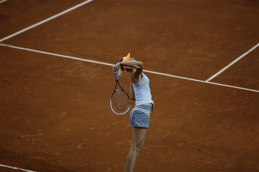 Russia's Maria Sharapova serves the ball to Spain's Garbine Muguruza during their match at the Italian Open tennis tournament in Rome, Wednesday, May 15, 2013