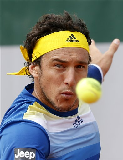 Argentina's Juan Monaco returns the ball to Spain's Daniel Gimeno Traver during their first round match of the French Open tennis tournament at the Roland Garros stadium Monday, May 27, 2013 in Paris