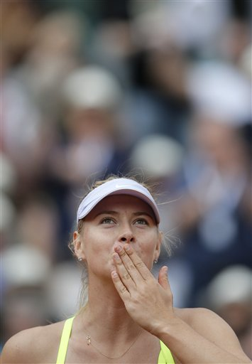 Russia's Maria Sharapova blows a kiss to