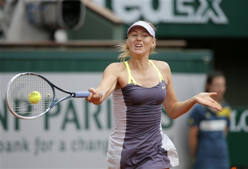 Russia's Maria Sharapova returns the ball to China's Jie Zheng during their third round match of the French Open tennis tournament at the Roland Garros stadium Saturday, June 1, 2013 in Paris. Sh