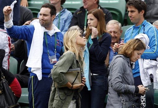 Maria Sharapova of Russia, centre, leaves the court after Grega Zemlja of Slovenia defeated her boyfriend Grigor Dimitrov of Bulgaria in a Men's second round singles match at the All England Lawn Tennis Championships in Wimbledon, London, Friday, June 28, 2013