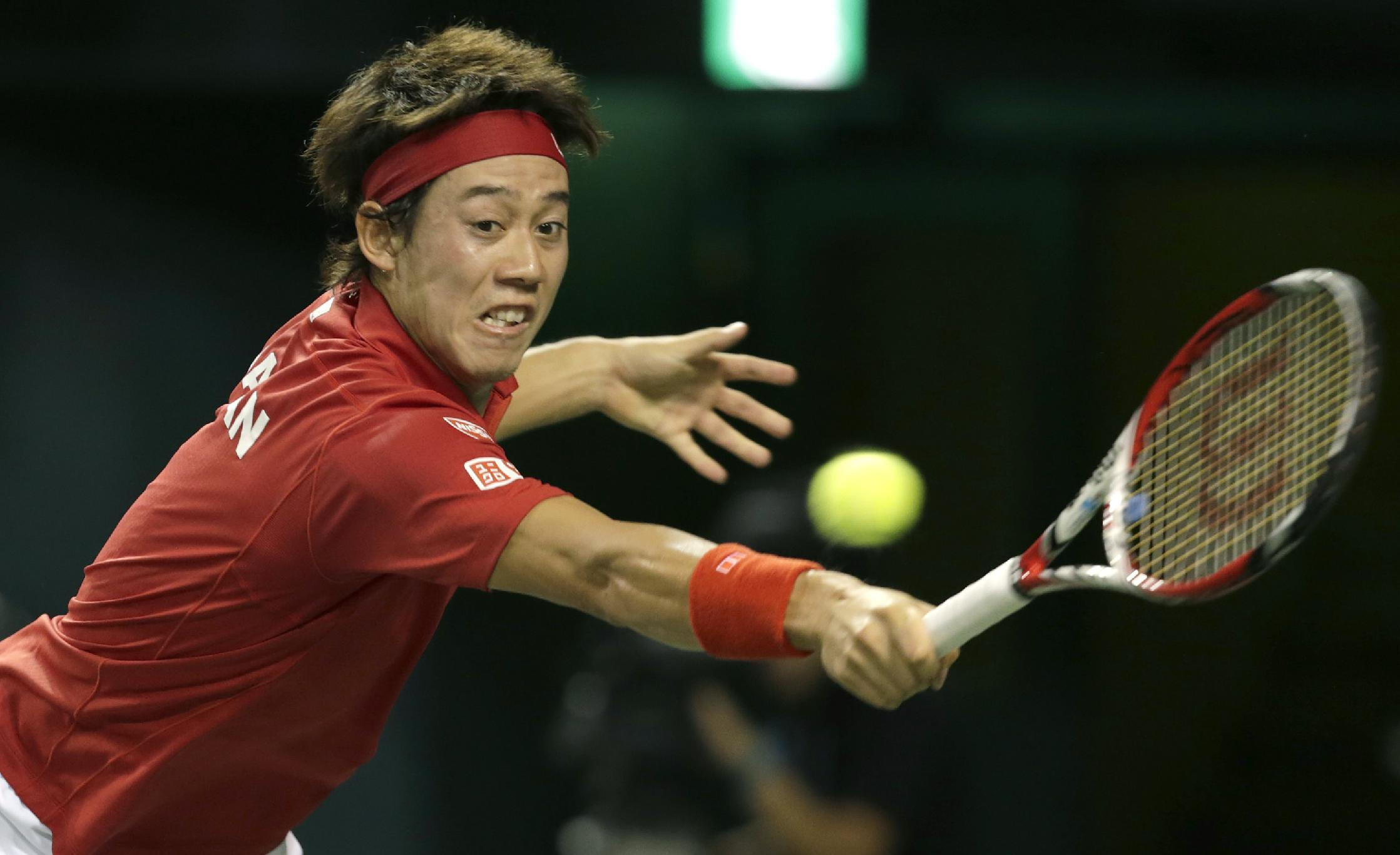 Kei Nishikori of Japan returns a shot to Colombia's Santiago Giraldo during the Davis Cup World Group play off in Tokyo, Sunday, Sept. 15, 2013. Nishikori won 6-1, 6-2, 6-4