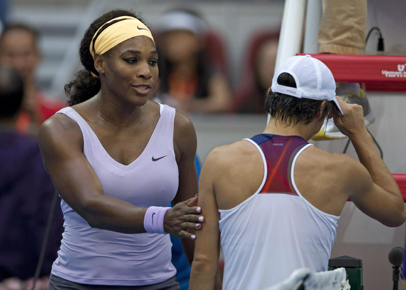 Serena Williams of the U.S., left, talks to Francesca Schiavone of Italy at the net after their second round match of the China Open tennis tournament at the National Tennis Stadium in Beijing, China Tuesday, Oct. 1, 2013. Williams won 6-4, 7-5