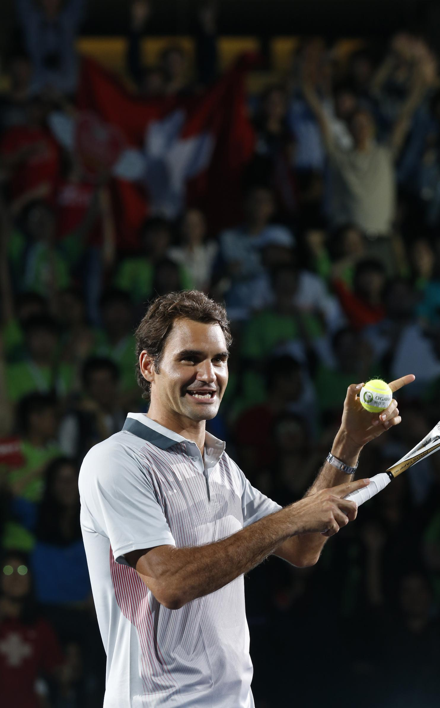 Roger Federer of Switzerland gestures during a fan meeting event ahead of the Shanghai Masters at Qizhon Tennis Center in Shanghai, China, Saturday, Oct. 5, 2013
