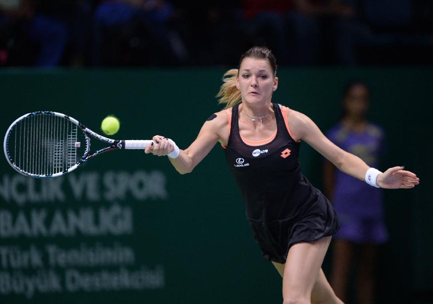 Agnieszka Radwanska of Poland returns a shot to Serena Williams of the USA during their tennis match at the WTA championship in Istanbul, Turkey, Wednesday, Oct. 23, 2013. The world's top female tennis players compete in the championships which runs from Oct. 22 until Oct. 27. (AP Photo)