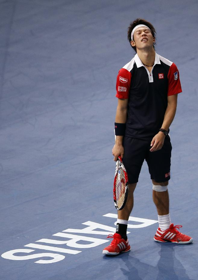 Japan's Kei Nishikori reacts after missing a ball to France's Jo-Wilfried Tsonga, during their second round match, at the Paris Masters tennis at Bercy Arena in Paris, France, Tuesday, Oct. 29, 2013
