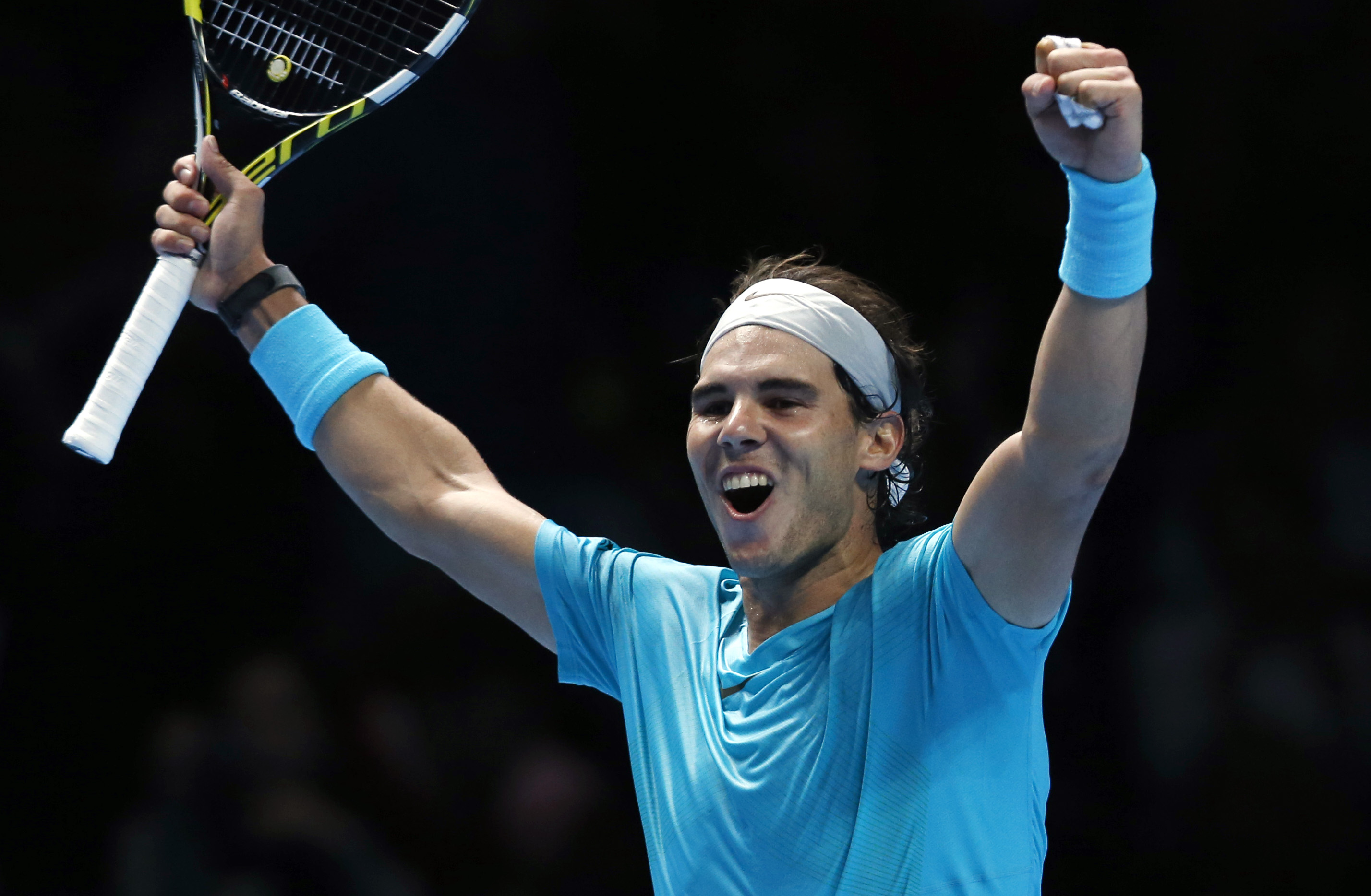 Rafael Nadal of Spain celebrates after winning the ATP World Tour Finals singles tennis match against Stanislas Wawrinka of Switzerland at the O2 Arena in London Wednesday, Nov. 6, 2013