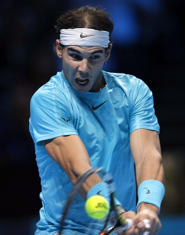 Rafael Nadal of Spain plays a return to Novak Djokovic of Serbia during the final of the ATP World Tour Finals singles tennis match at the O2 Arena in London Monday, Nov. 11, 2013