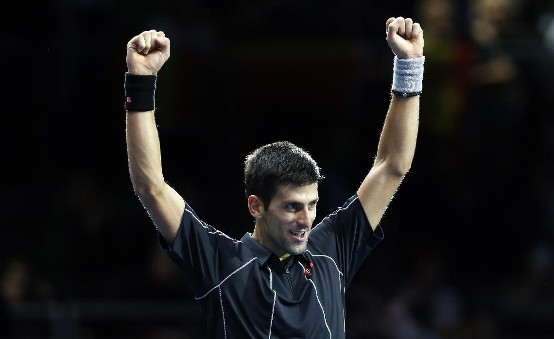 Novak Djokovic of Serbia celebrates after winning the final of the ATP World Tour Finals singles tennis match against Rafael Nadal of Spain at the O2 Arena in London Monday, Nov. 11, 2013