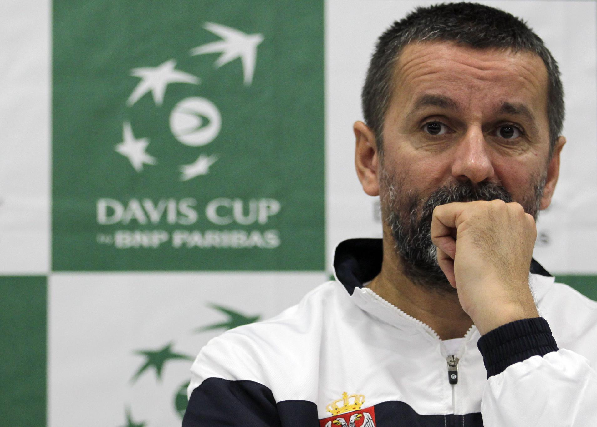Serbian Davis Cup team captain Bogdan Obradovic attends a news conference in Belgrade, Serbia, Wednesday, Nov. 13, 2013. Serbia will play against Czech Republic for the Davis Cup Final starting on November 15-17, in Belgrade