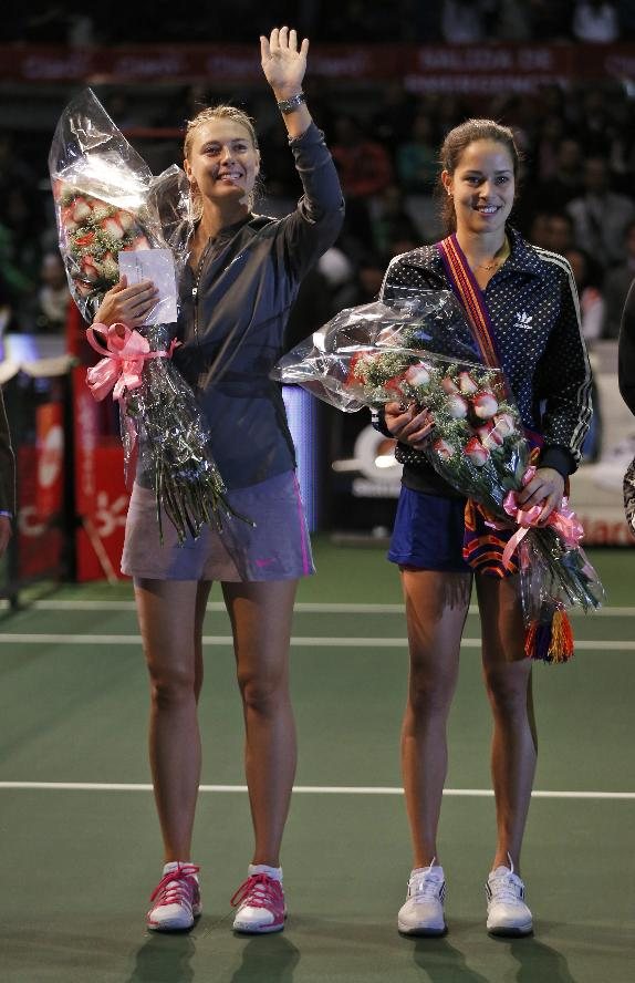 Russian tennis player Maria Sharapova, left, and Serbian Ana Ivanovic pose for photos after an exhibition game in Bogota, Colombia, Friday, Dec. 6, 2013